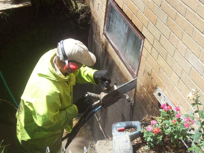 Cutting A Hole In Wall : Cut egress window hole in basement wall with hydraulic
